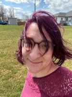 Me, with my hair dyed fuschia, out walking on a breezy, sunny day.